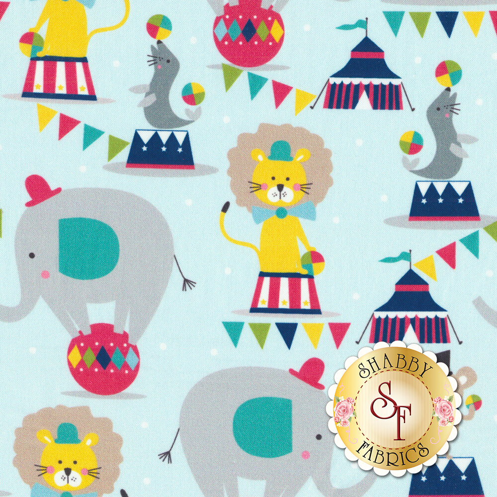 A kid's fabric featuring balancing elephants, seals, and lions at the circus | Shabby Fabrics
