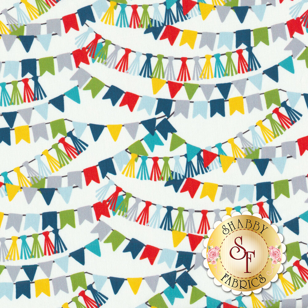 Multi colored party streamers hanging over a white background   Shabby Fabrics