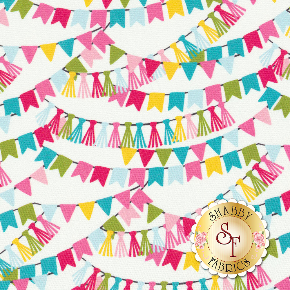Multi colored party streamers hanging over a white background | Shabby Fabrics