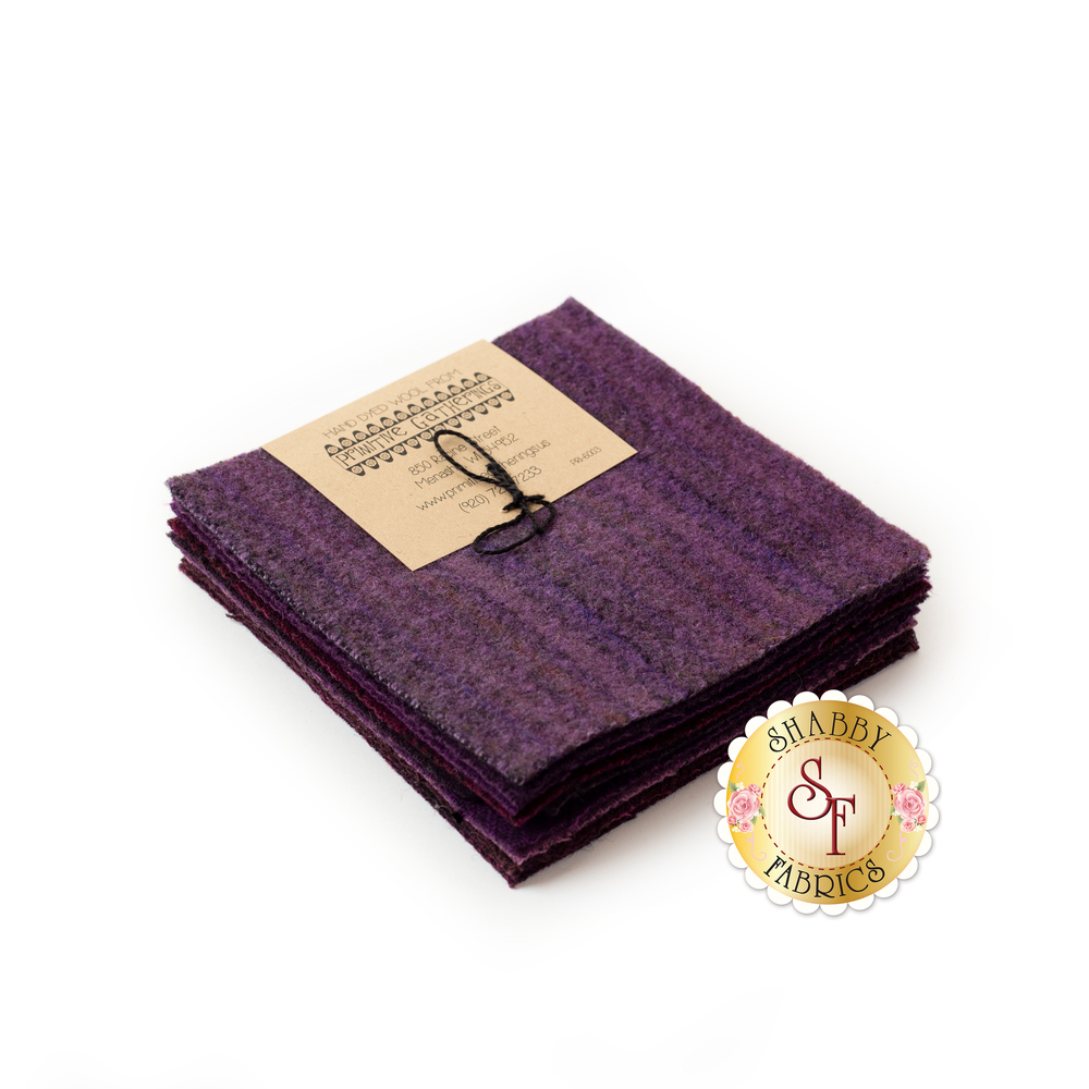 """A set of 5"""" purple Wool squares stacked with a cute label"""