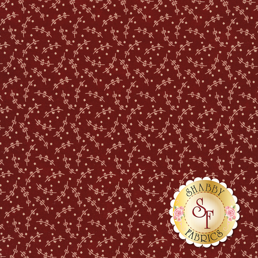 Cream tossed leaves and vines on a red background | Shabby Fabrics