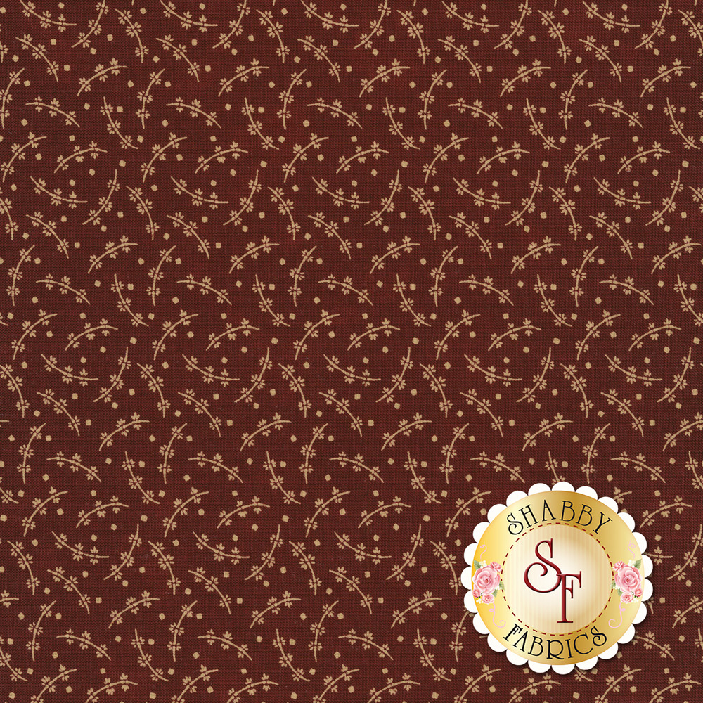 Cream tossed leaves and vines on a dark red background | Shabby Fabrics