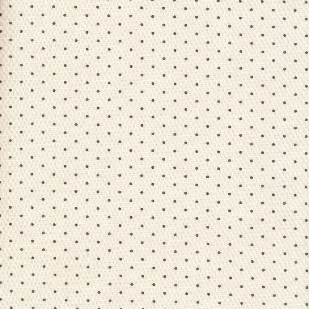 Black polka dots on a cream background