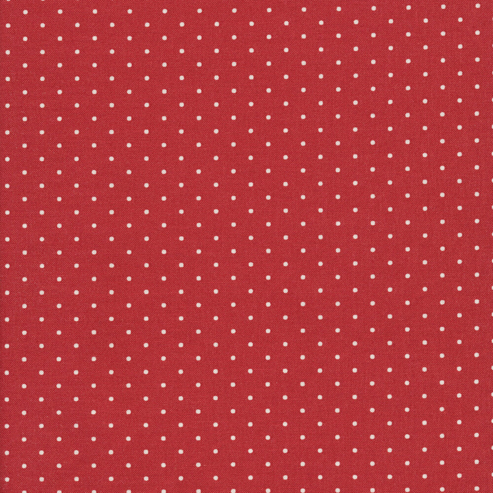 White polka dots on a red background
