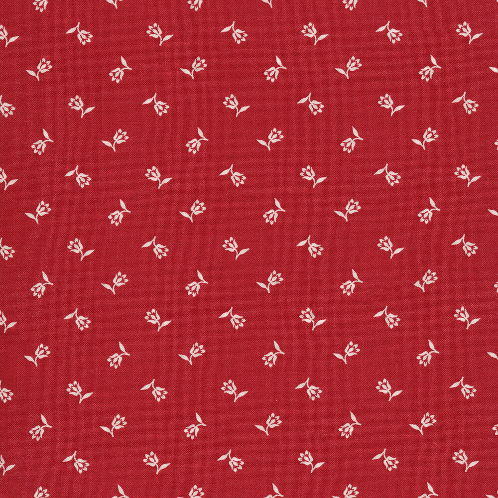 Tossed ditsy flowers on a red background