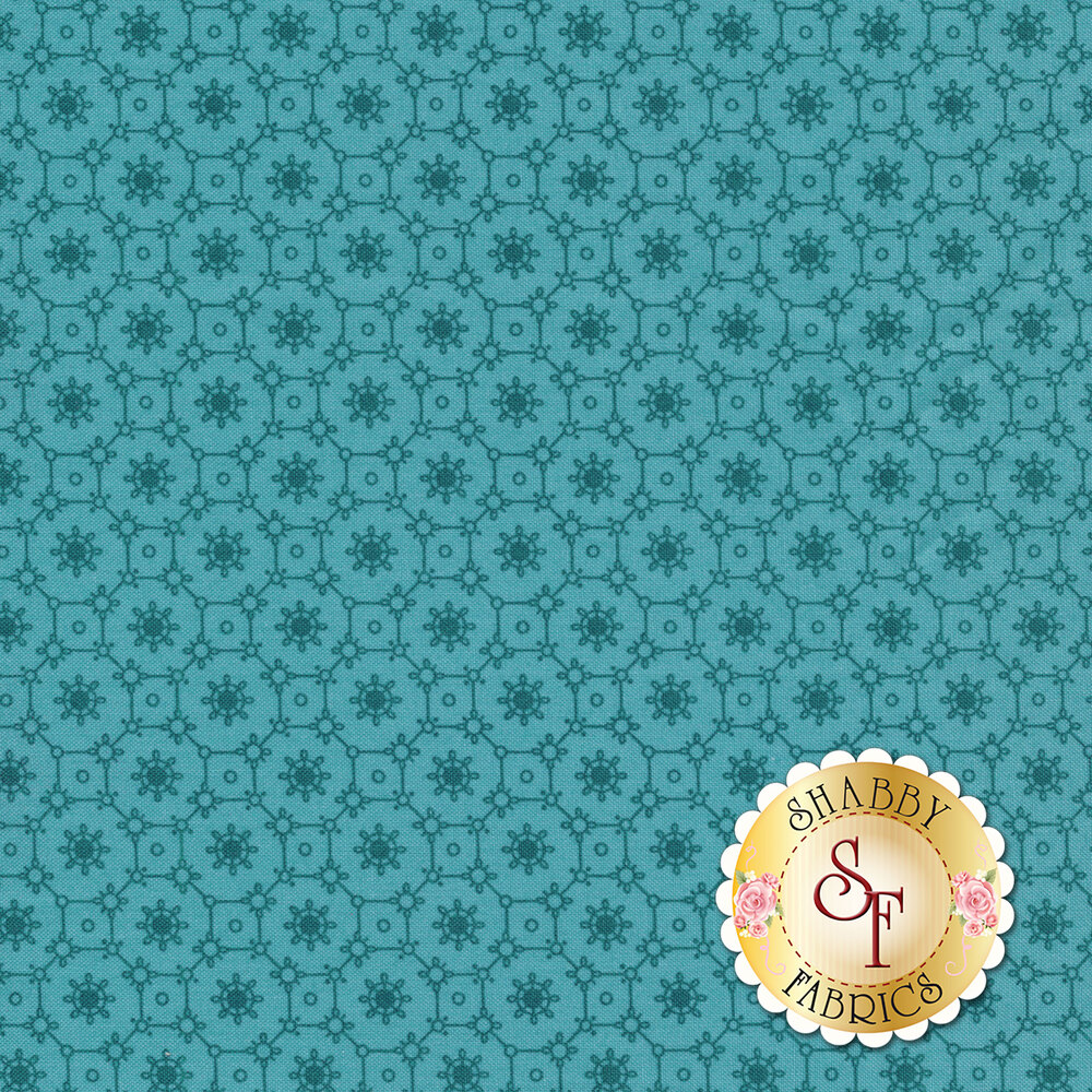 A blue tonal fabric with a floral and geometric tiled pattern | Shabby Fabrics