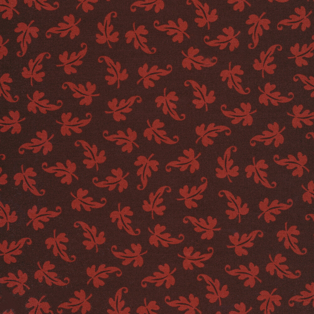 Tossed tonal leaves on a dark red background | Shabby Fabrics