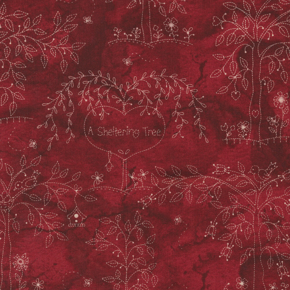 "Red marbled fabric featuring cream trees with words ""A Sheltering Tree"" 