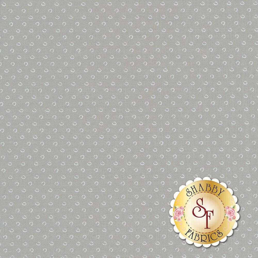 Small pebbles on a dark grey background | Shabby Fabrics