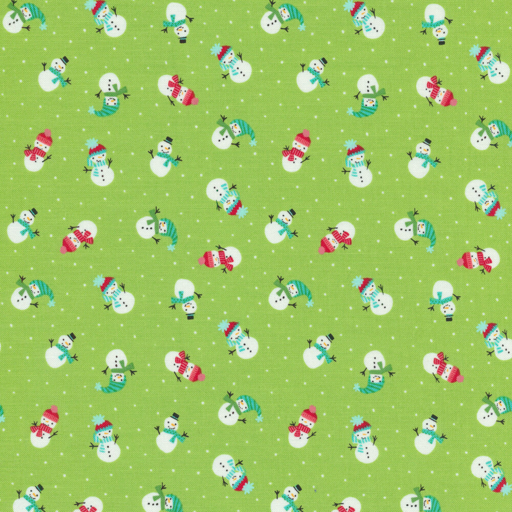 Small white snowmen and dots scattered on light green | Shabby Fabrics