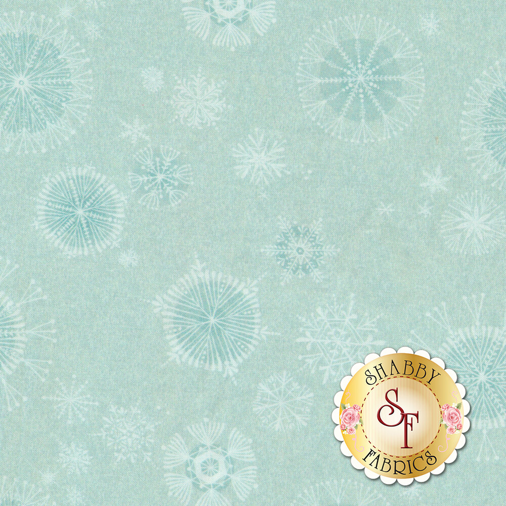 An aqua tonal fabric with a variety of snowflakes all over | Shabby Fabrics