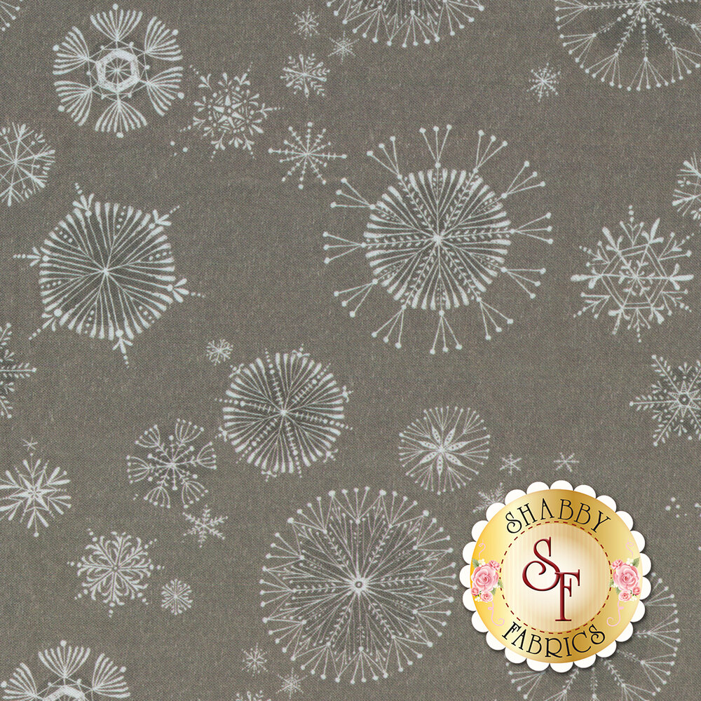 A variety of white snowflakes all over on a grey background   Shabby Fabrics
