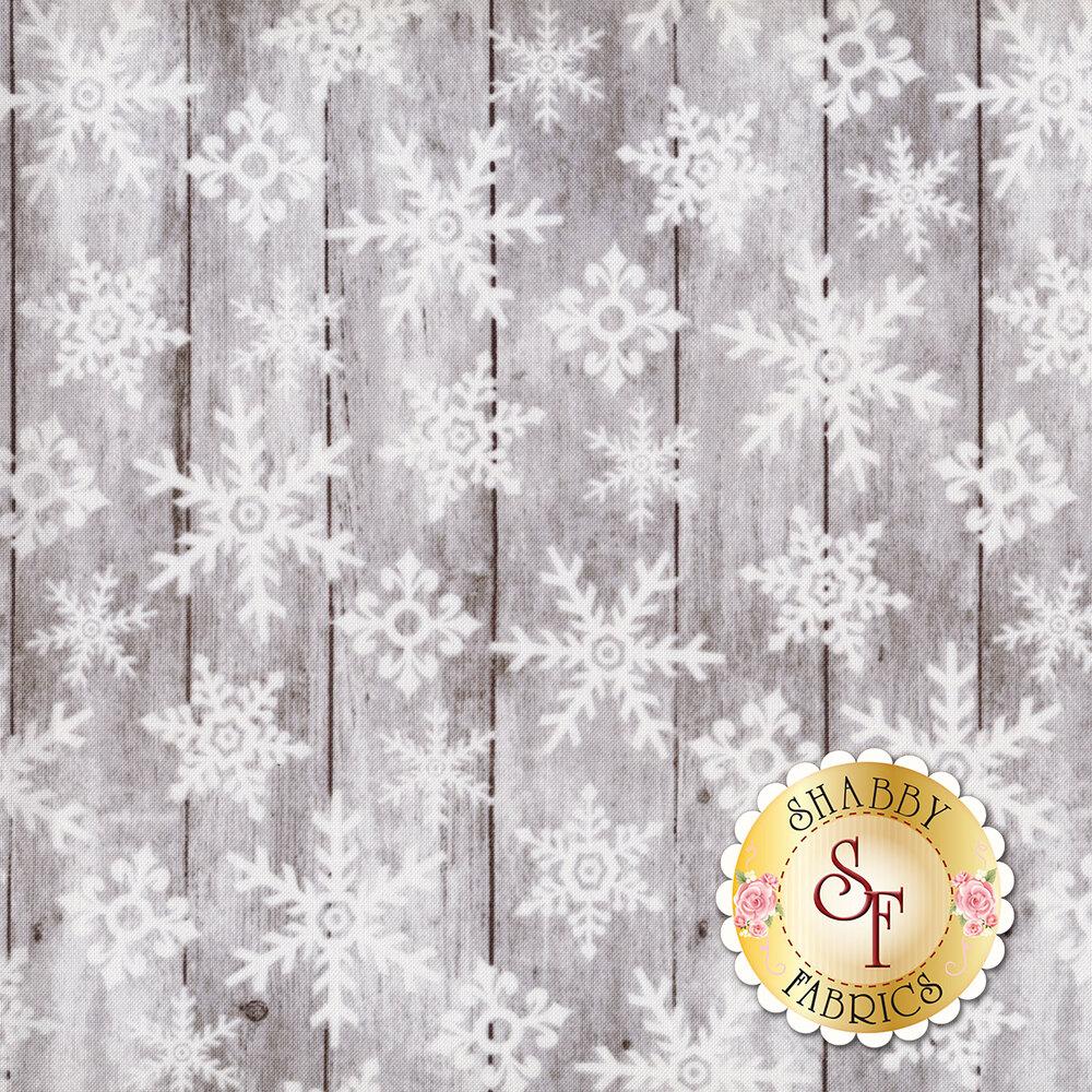 White snowflakes on gray wood | Shabby Fabrics