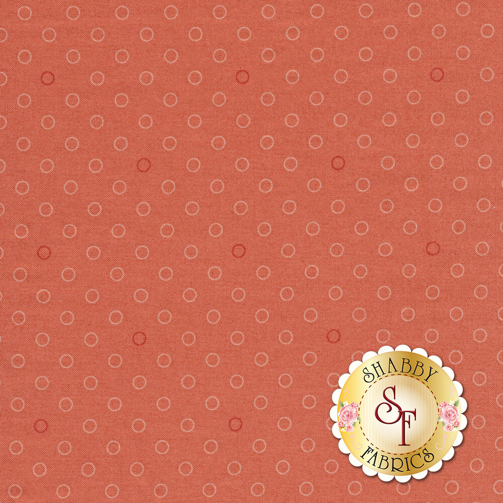 A basic coral polka dot fabric with tonal rings | Shabby Fabrics