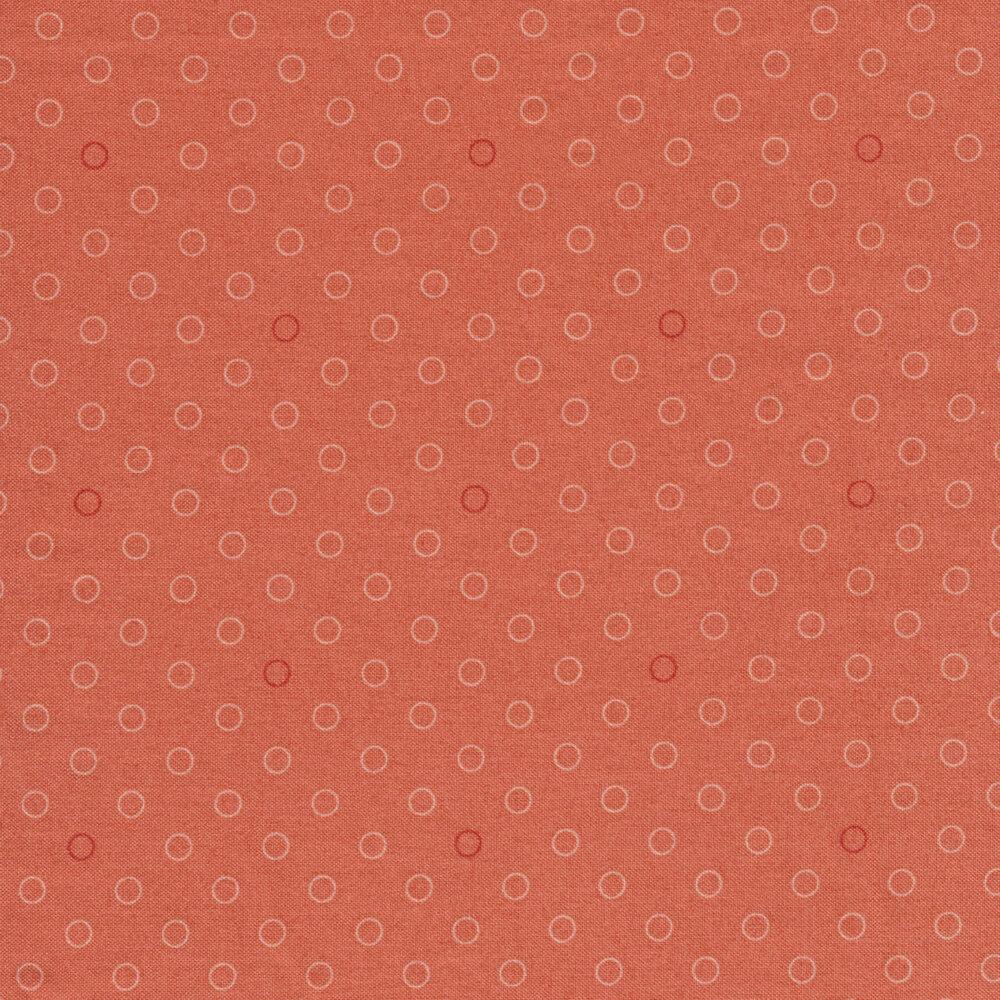 A basic coral polka dot fabric with tonal rings | Shabby Fabrics