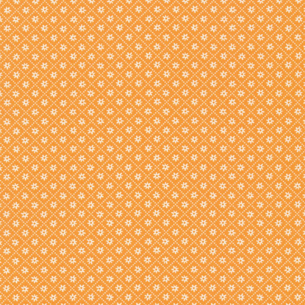 Tiny white flowers in the middle of small orange diamonds | Shabby Fabrics