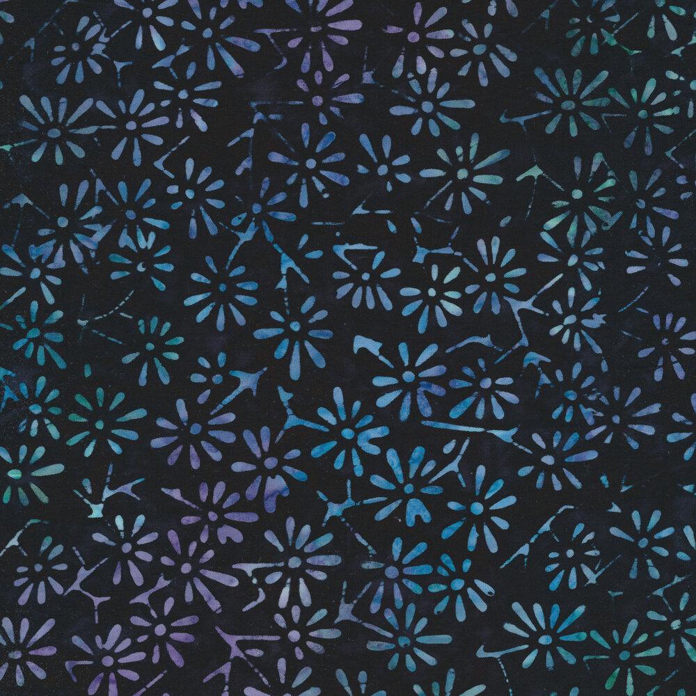 Tossed flower designs on a mottled blue background