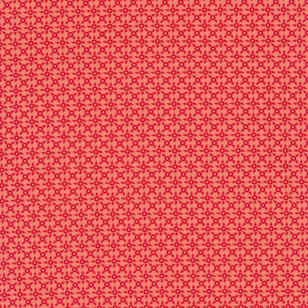 Red ditsy print on a pink background