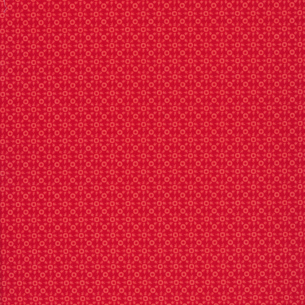 Pink ditsy print on a red background