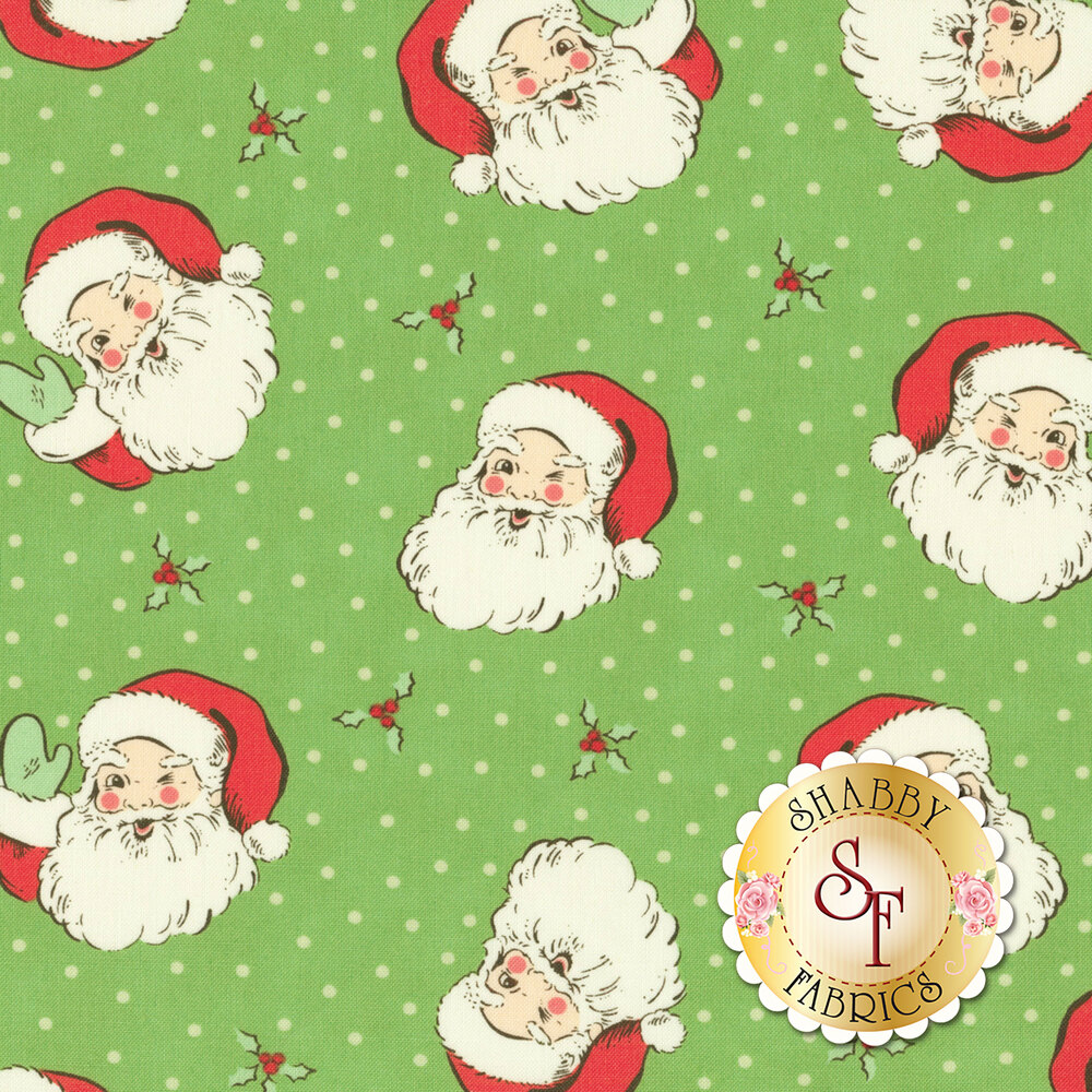 Tossed Santa Claus heads on green with cream dots and holly | Shabby Fabrics