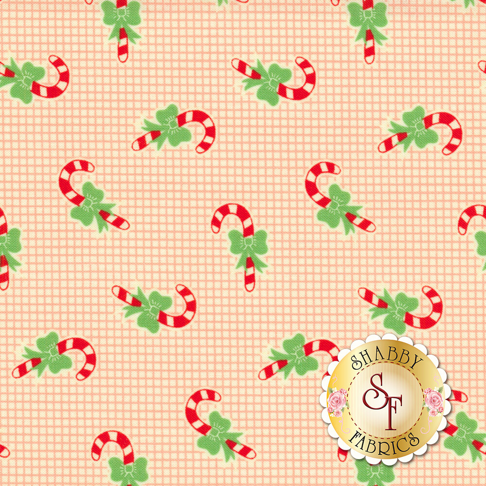 Candy canes with green bows tossed on pink and cream grid | Shabby Fabrics