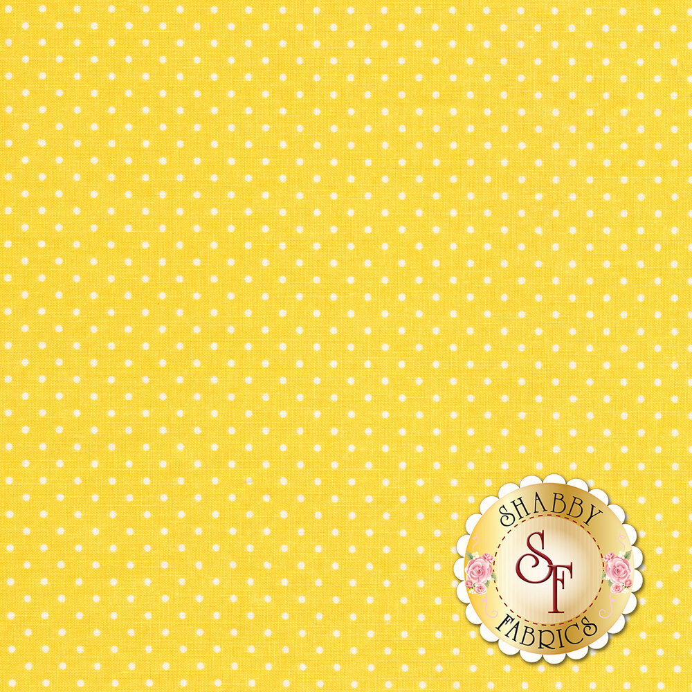 A yellow fabric with small white polka dots | Shabby Fabrics