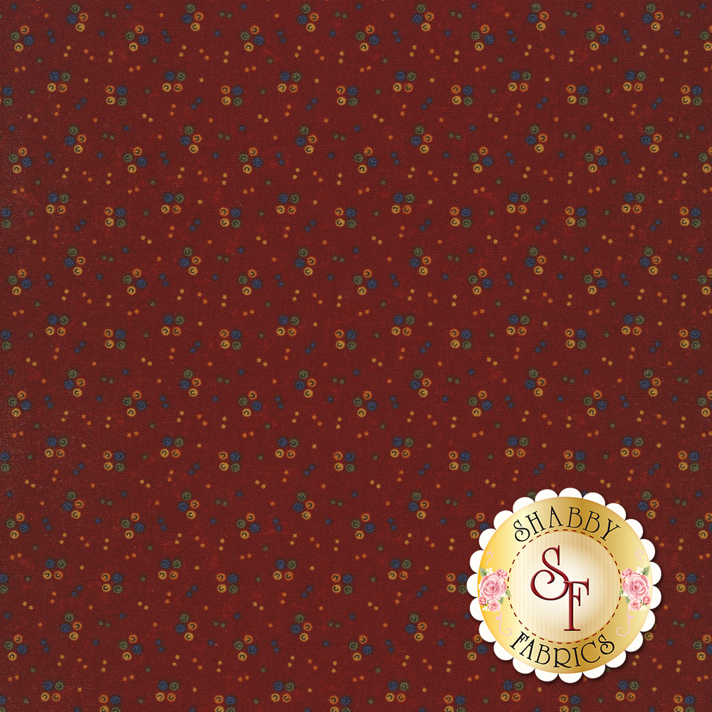 Multi colored spots on a red background | Shabby Fabrics