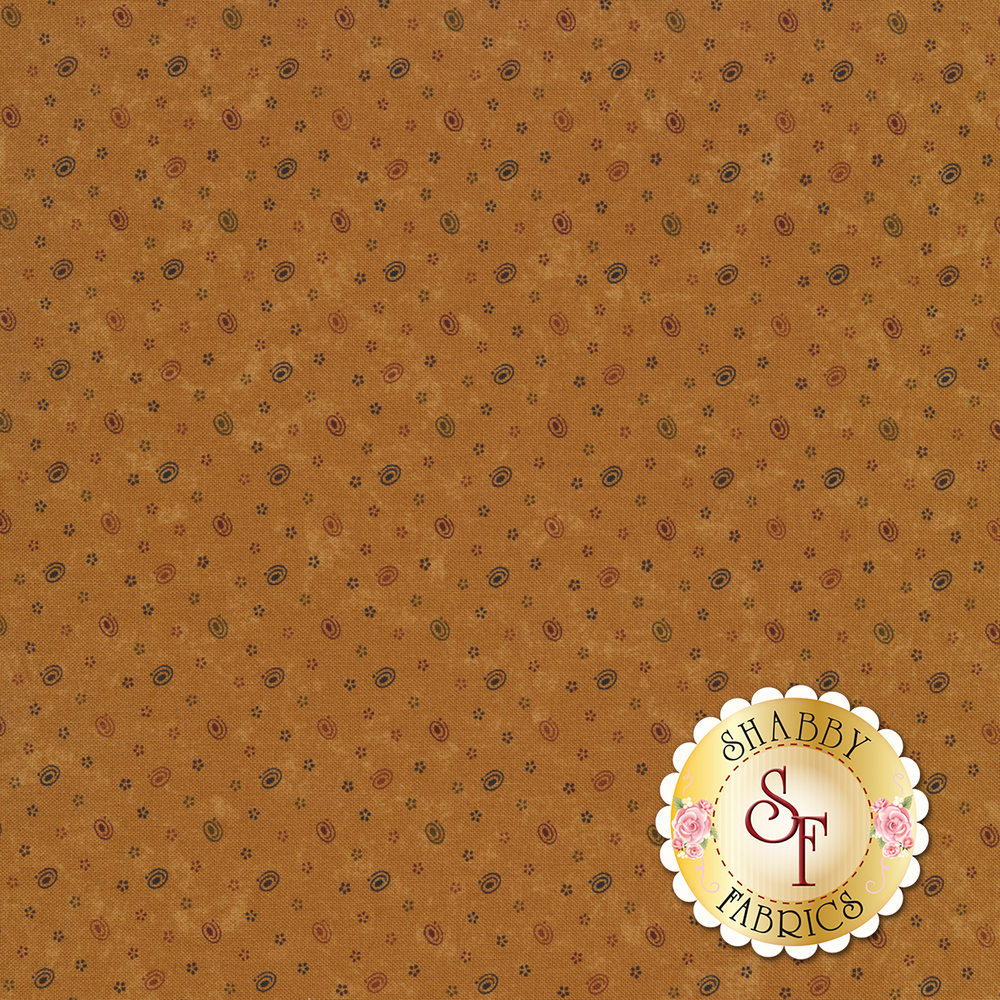 Swirls and small stars on a distressed brown background | Shabby Fabrics
