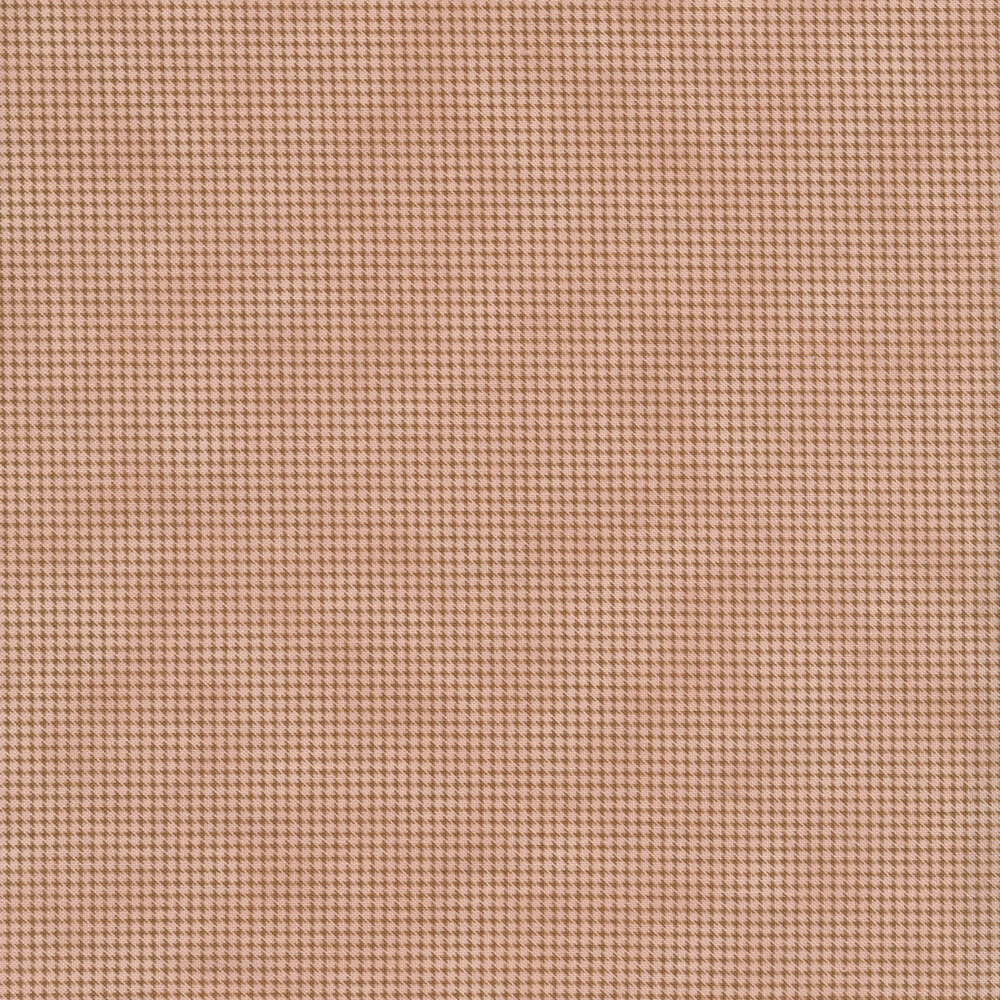 Light pink mottled fabric with dark houndstooth patterns all over