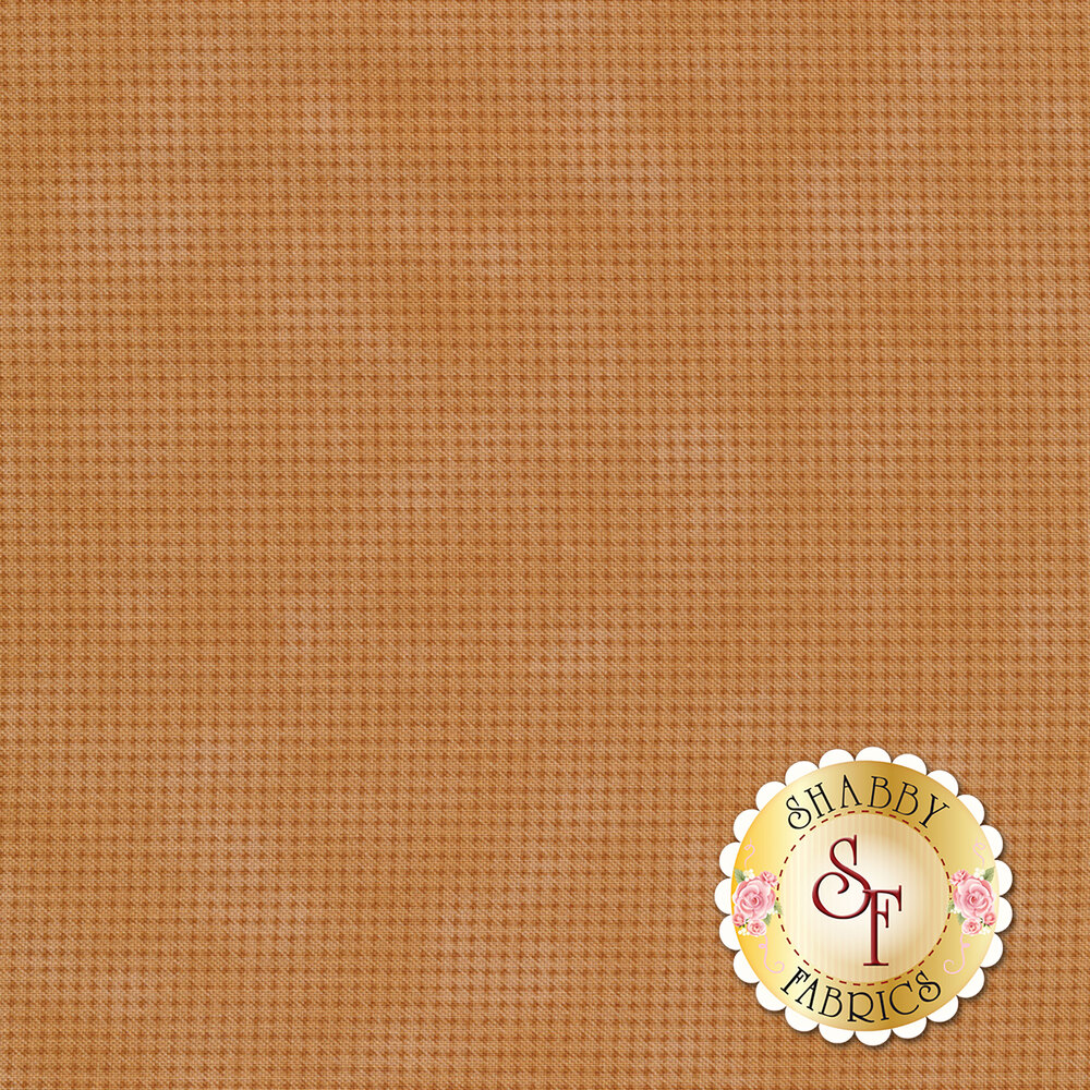 Brown mottled fabric with dark brown houndstooth patterns all over