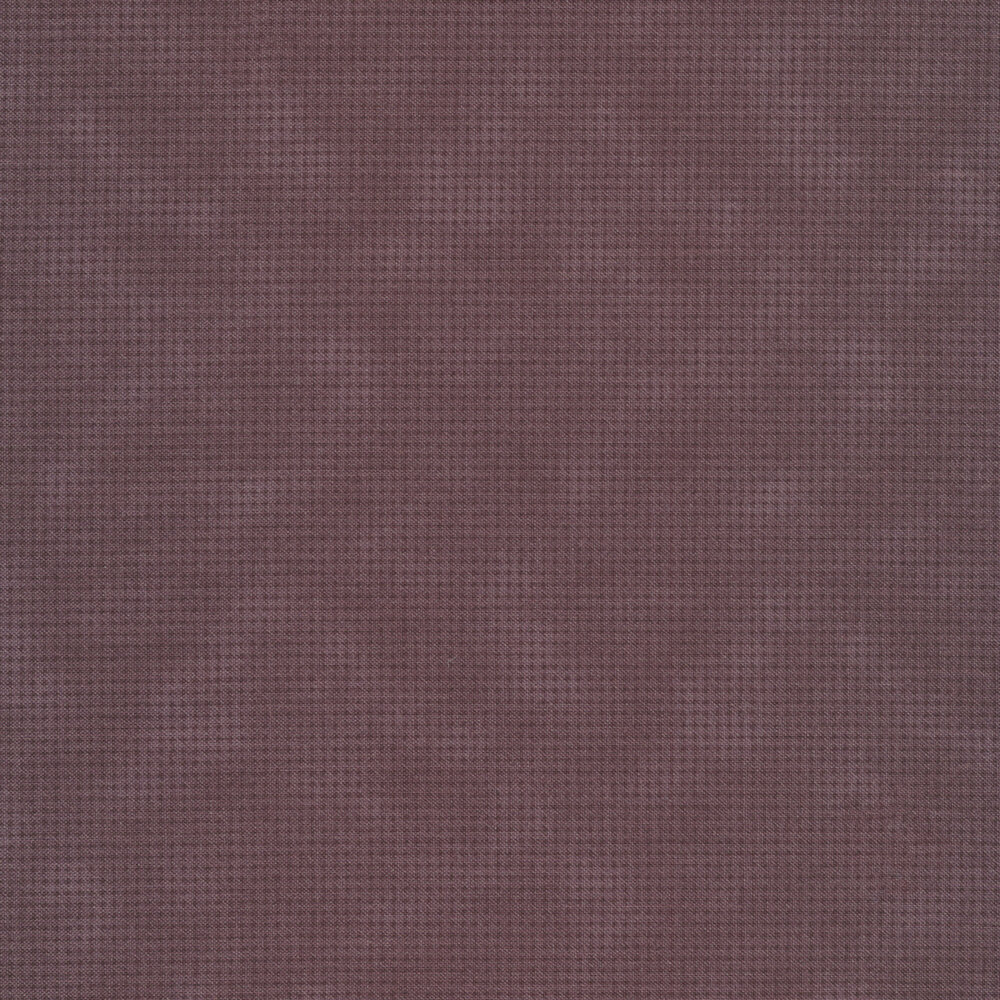 Tonal purple mottled fabric with houndstooth patterns all over