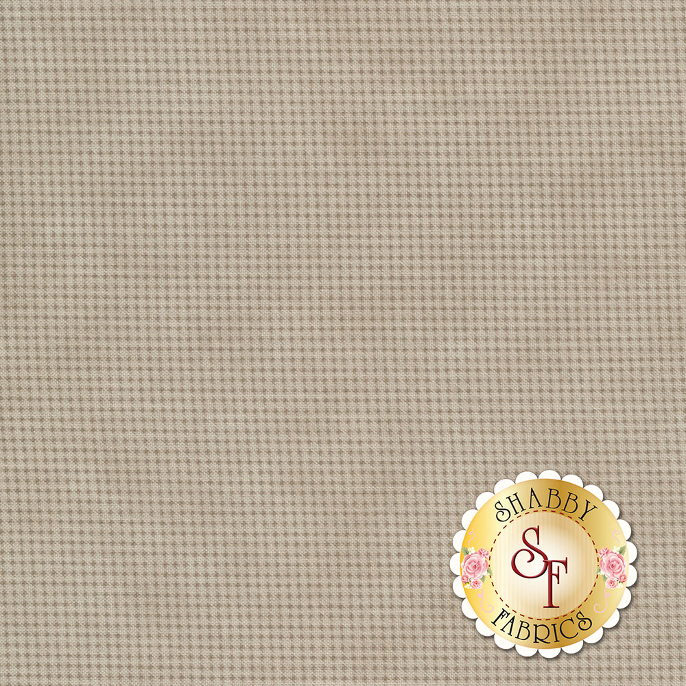 Tonal greige mottled fabric with houndstooth patterns all over
