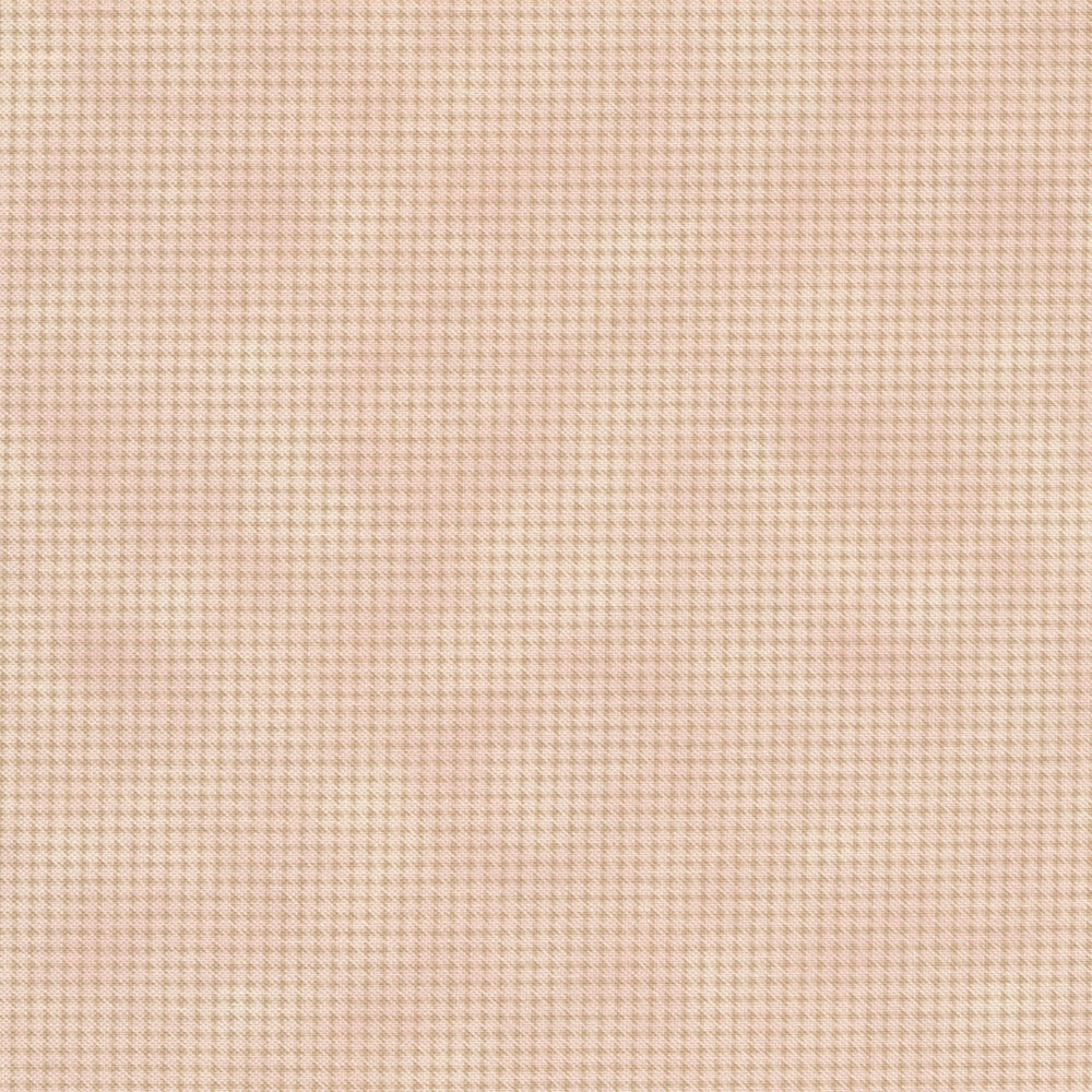 Tonal light pink fabric with houndstooth patterns all over