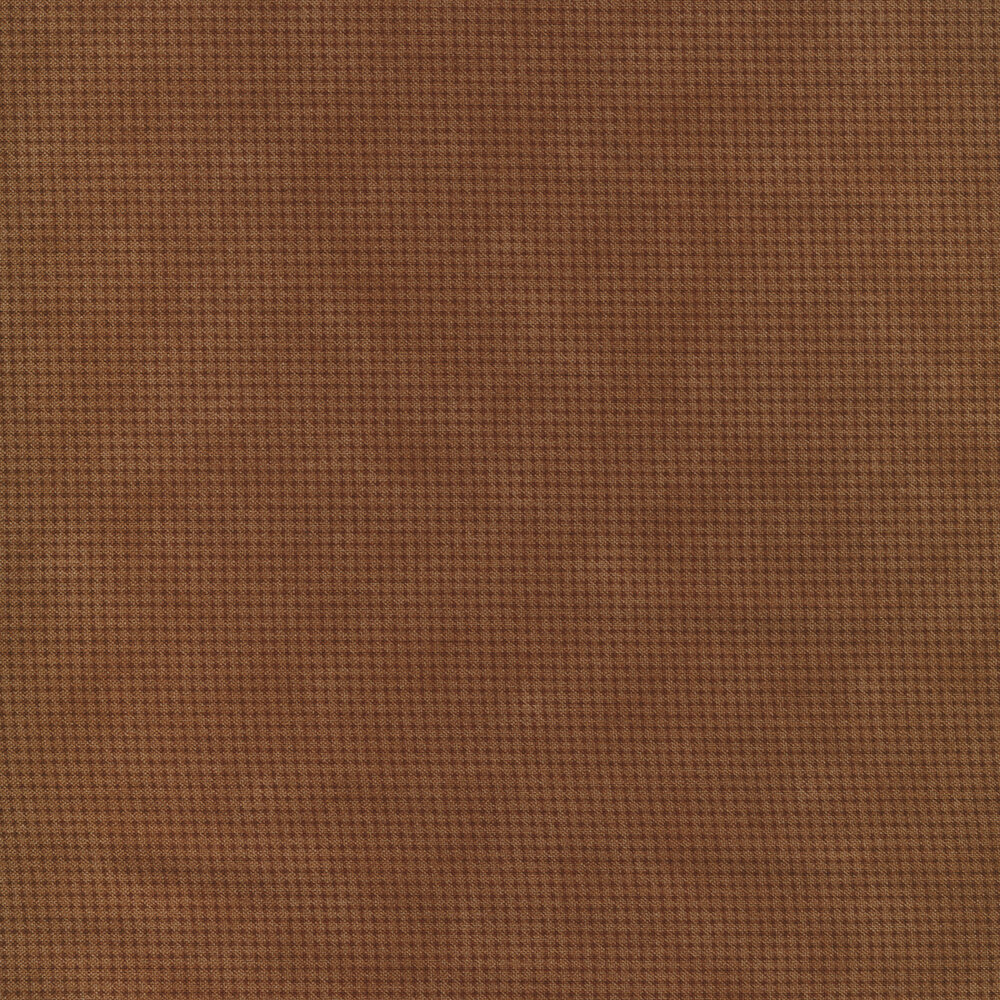 Tonal dark brown fabric with houndstooth patterns all over