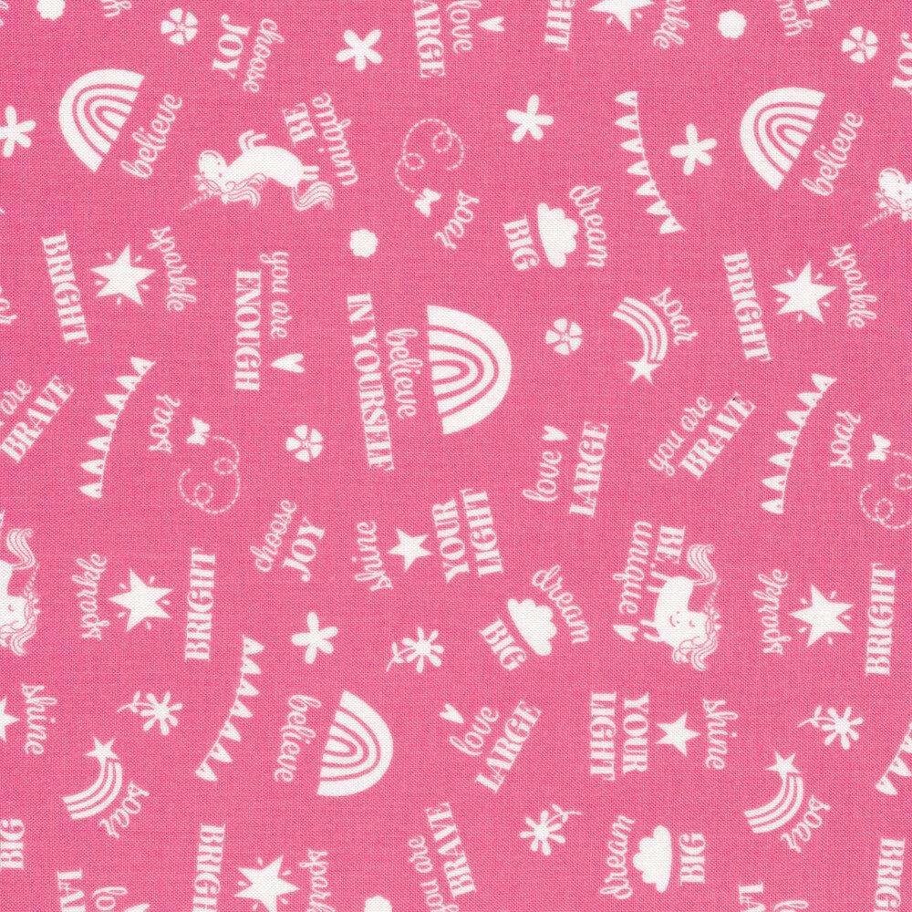 Tossed words, unicorns, and rainbows on pink | Shabby Fabrics