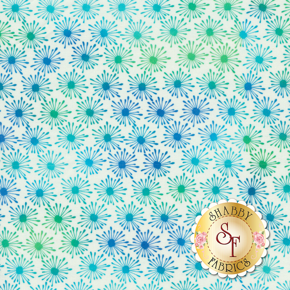 Blue and green star bursts all over white | Shabby Fabrics