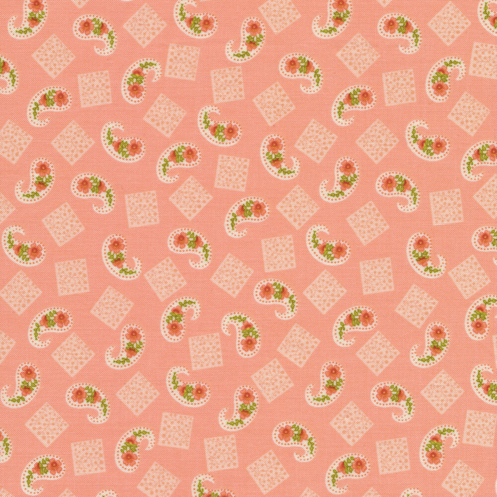 Fabric featuring beautiful tossed paisleys and squares on a pink background