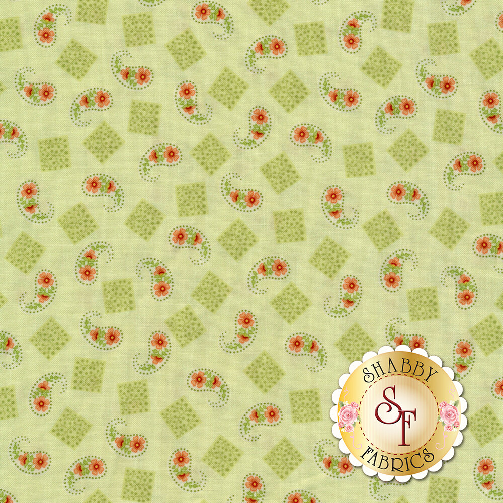 Fabric featuring beautiful tossed paisleys and squares on a green background