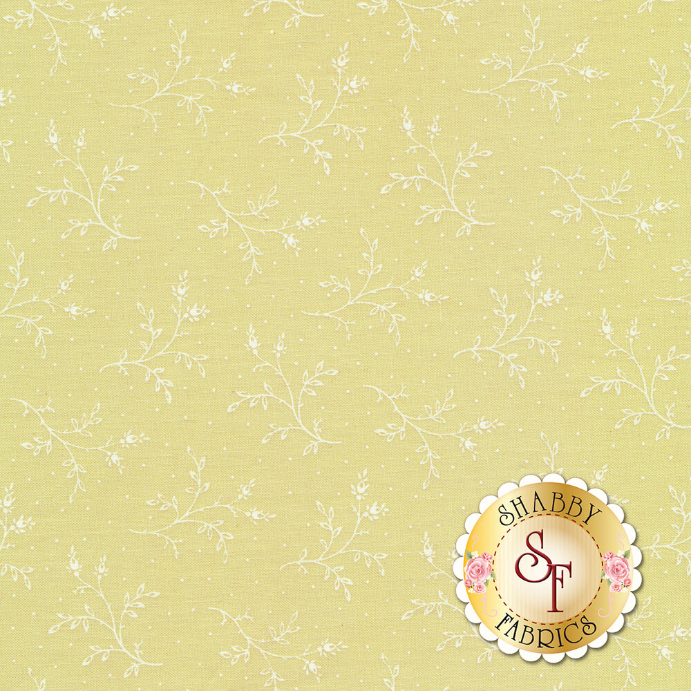 Tossed white sprigs on a mint green background with small white dots | Shabby Fabrics