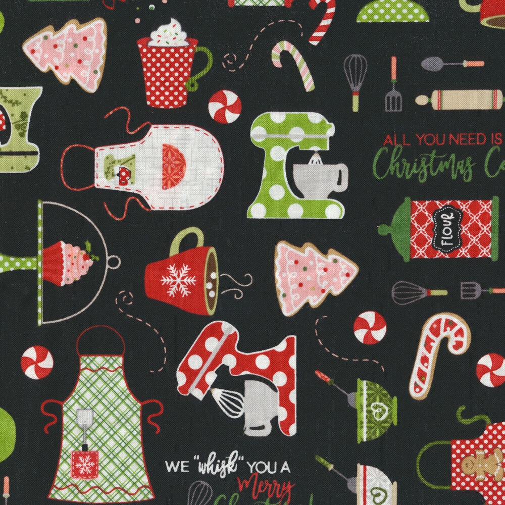 Fun baking utensils and Christmas cookies scattered on a black background | Shabby Fabrics