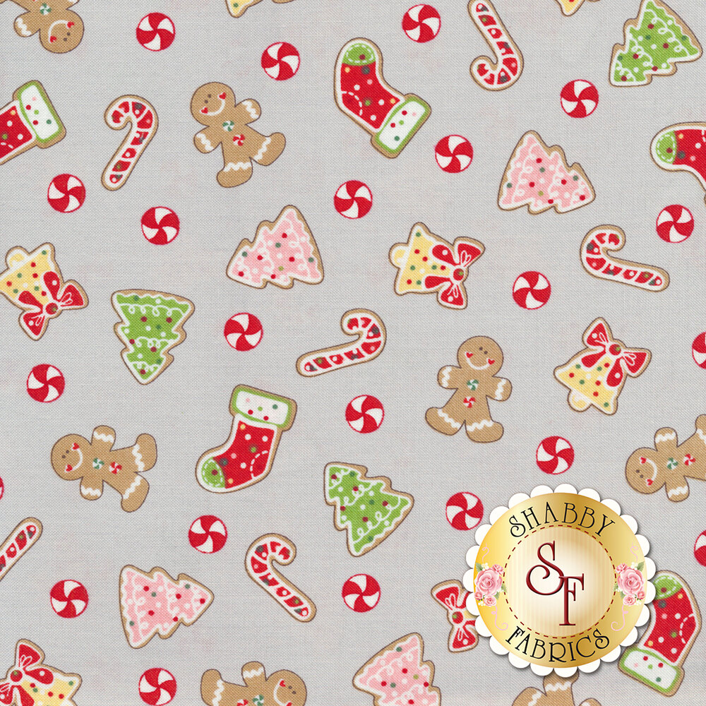 Tossed Christmas cookies and gingerbread men with mints on a grey background | Shabby Fabrics