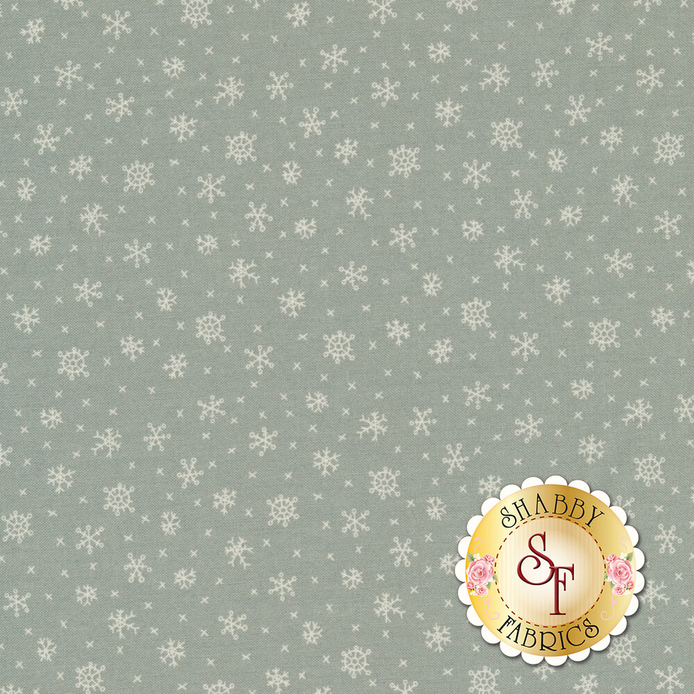 A classic snowflake print with beautiful white snowflakes on a grey blue background | Shabby Fabrics