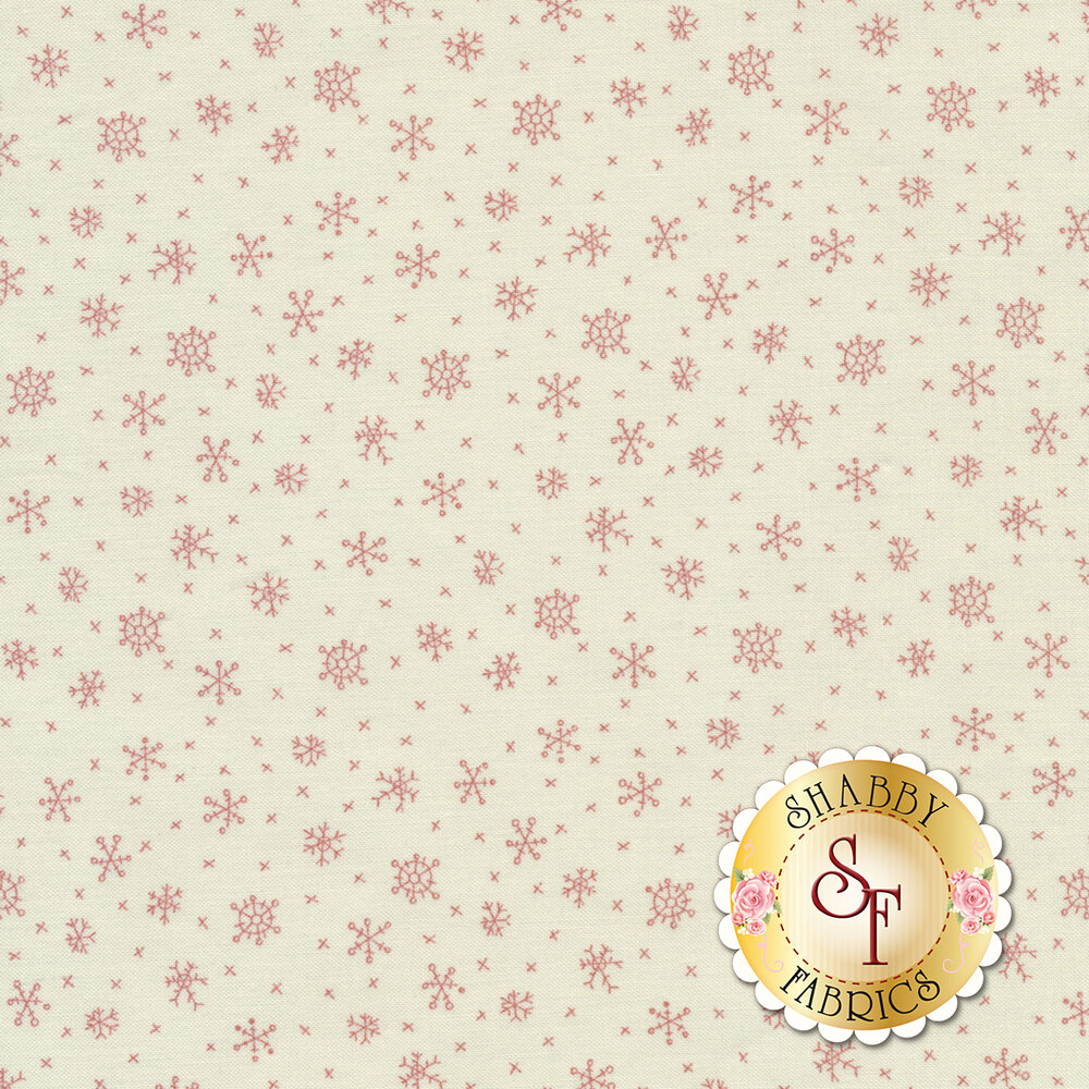A classic snowflake print with red snowflakes on a cream background | Shabby Fabrics