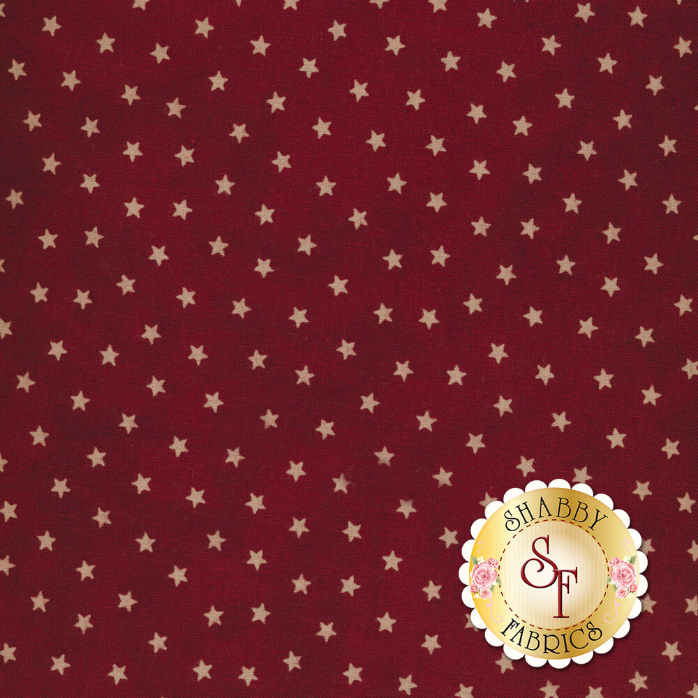 Small cream stars on mottled dark red | Shabby Fabrics