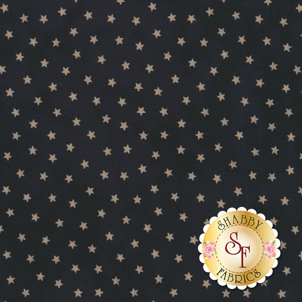 Small cream stars on mottled dark blue background | Shabby Fabrics