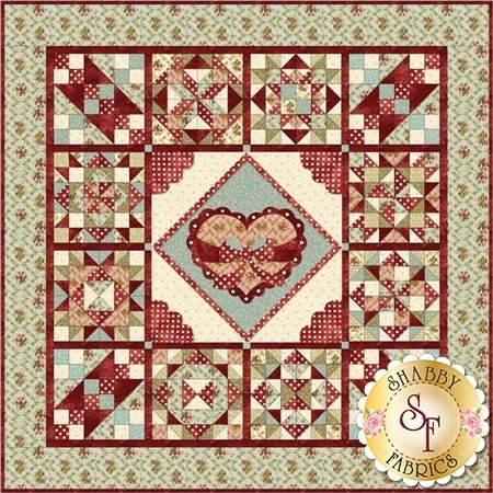 Large central heart applique on shabby chic green and cream patchwork.