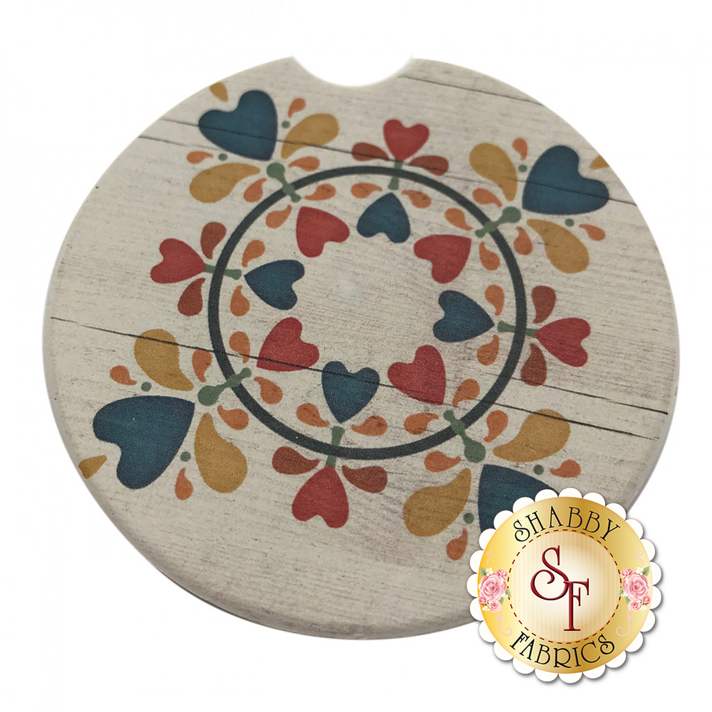 Circular stone car cup holder coaster with a ring of hearts