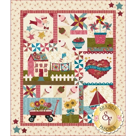 A pastel pink and cream quilt with appliqued summer motifs.
