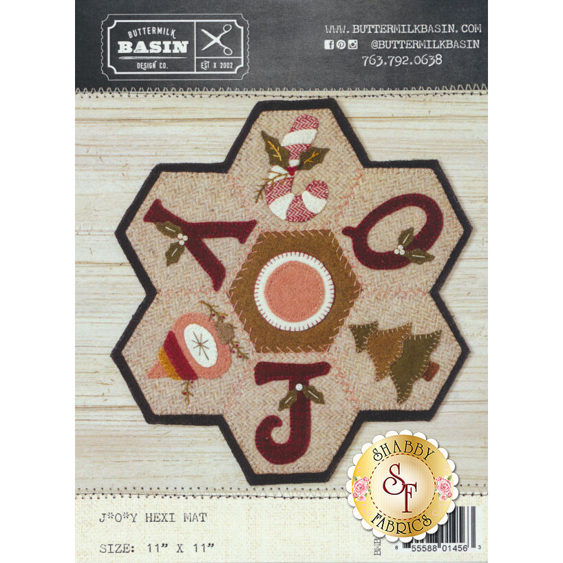 The front of the J*O*Y Hexi Mat Pattern showing a finished Christmas hexi mat | Shabby Fabrics