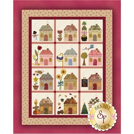 A 12 block applique BOM with rows of monthly themed cottages.